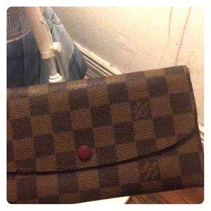 A women's Louis Vuitton wallet
